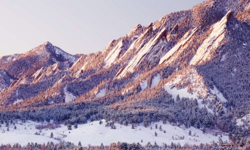 snow on the flatirons in boulder